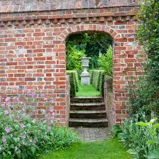 The Kitchen Garden Is Accented By A New Stoneandbrick Wall And A - Wall garden design