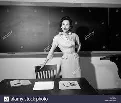 Leaning Chair Standing Desk by 1950s Teacher Standing In Front Of Blackboard Leaning On