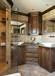 dual bathroom sinks with middle cabinet corner vanity design