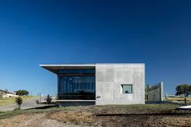 concrete dermatology office by matt fajkus overlooks texas hill