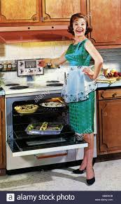 1960 Kitchen by Household Kitchen And Kitchenware Woman At Stove In Front Of