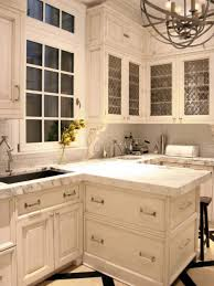 kitchen floating island granite countertop cream colored cabinets with white appliances