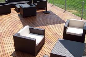 patio wooden deck flooring options with lounge chair black rattan