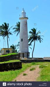 galle fort lighthouse and palm trees stock photo royalty free
