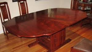 wonderful wooden dining room table with 8 wood chairs pads have