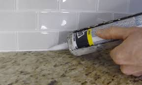 How To Install Glass Mosaic Tile Backsplash In Kitchen by How To Install Caulk On A Kitchen Tile Backsplash Youtube