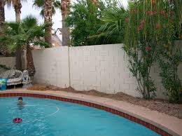 what a little stucco and paint can do for your block fence tukee