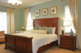sherwin williams tidewater in a bedroom with darker furniture