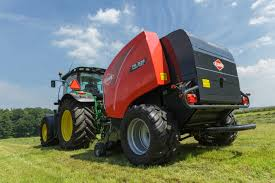 a round baler that opens closes and u0027unblocks u0027 all by itself