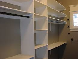 Wooden Closet Shelves by Shared Closet Storage Systems With Husband Mahogany Wood Design
