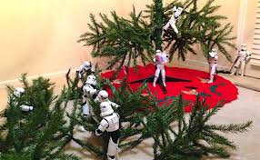 stormtroopers and darth vader put up tree in hilarious