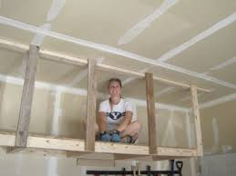 Building Wood Shelf Garage by Best 25 Overhead Garage Storage Ideas On Pinterest Diy Garage