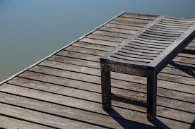 wooden bench on pier or dock stock photo image 50967270