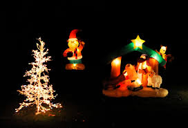 an inflatable nativity scene lights up jim canady u0027s home in fair