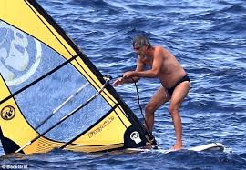 Blind Italian Singer Time To Say Goodbye Andrea Bocelli 58 Windsurfs On Vacation With His Family Daily