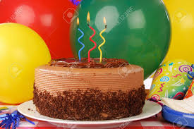 a delicious chocolate birthday cake with three candles and