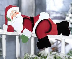 funny sleeping santa christmas yard decoration fence railing porch