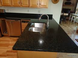 granite countertop kitchen colour schemes with white cabinets