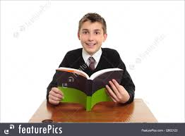 Picture Of Student Sitting At Desk picture of happy school student with textbook