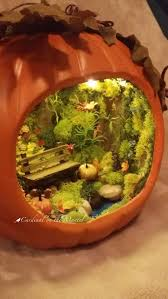 garden in pumpkin by cardinal on the mantel note lights and