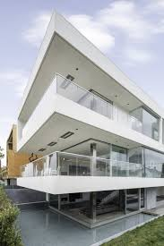 mesmerising motion of the ocean sleek house situated next to the