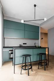 best 25 green kitchen interior ideas on pinterest green kitchen colourful accents offset grey walls in vilnius apartment renovation by akta apartment kitchenapartment interiorkitchen