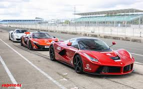 porsche mclaren p1 watch the laferrari mclaren p1 and porsche 918 meet on track for