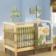 blue and green dinosaur baby boy monster nursery tree infant crib