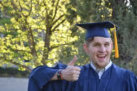 college graduation gown free images white student smiling