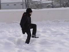 Making Backyard Ice Rink Packing Snow