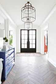 best 25 entry chandelier ideas on pinterest entryway chandelier beautiful entryway featuring double front doors hanging light fixtures and chevron flooring redo home home designinterior