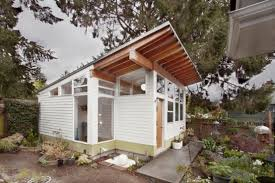 tiny backyard house filled with mid century finds digsdigs