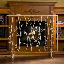 artistic decorative fireplace screen with light metal carvings on laminate floor
