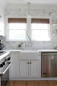 55 best blue and white interiors images on pinterest white bob vila and the ravenna house apron sink white cabinets with gray countertop and