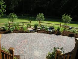 lowes pavers cement block tiles bordered by white pebbles for