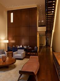 High Ceiling Living Room Designs by Living Room Decorating A Large Wall With High Ceiling For Using