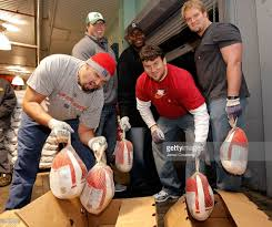 new york giants load trucks with thanksgiving dinner for the food