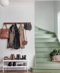 green stairs functional entryway coat rack and shoe table but