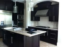 light granite countertops with dark cabinets dark cabinets light granite also warm the kitchen with dark cabinets