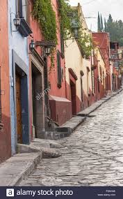 the spanish colonial style homes along the cobblestone correo
