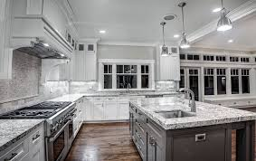 granite countertops and white kitchen cabinets call the