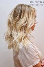 mid length curly blonde balyage blonde balyage ombre