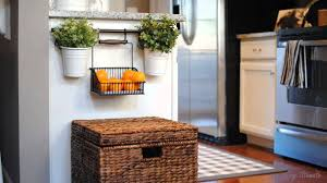 gray kitchen cabinets with hanging basket on2go