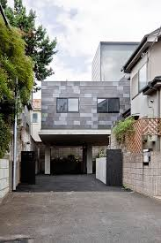 architecture awesome entrance view of modern house in eifukucho awesome entrance view of modern house in eifukucho with open garage design with concrete tile wall surrounded with green trees