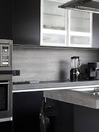 black glass backsplash kitchen modern kitchen gray countertop limestone kitchen backsplash