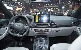 jeep j8 interior comparison chery exeed tx hybrid 2018 vs jeep wrangler jk