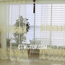 beautiful country flower patterned white and yellow sheer curtains