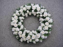 large white wreath of roses