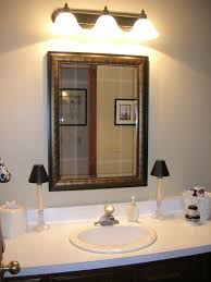 updated bathroom light with sconces over mirror for white double