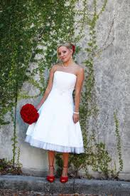 pictures on wedding white colour dress with ornaments pics